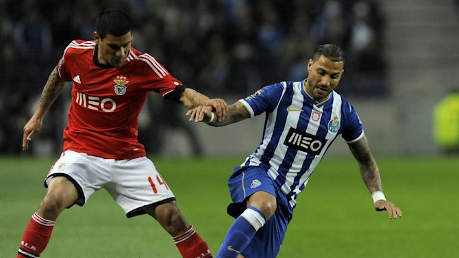 FC Porto's Ricardo Quaresma, right, is grabbed by Benfica's Maxi Pereira, from Uruguay, in a Portugal Cup semifinal first leg soccer match at the Dragao stadium in Porto, Portugal, Wednesday, March 26, 2014