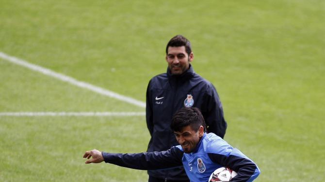 Porto's Lucho Gonzalez controls the ball near his coach Paulo Fonseca during their training session at Dragon stadium in Porto