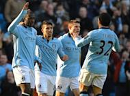 Manchester City midfielder Yaya Toure (L) celebrates with Sergio Aguero, James Milner and Carlos Tevez after scoring the opening goal of the fifth round English FA Cup football match against Leeds in Manchester on February 17, 2013. Manchester City's won 4-0