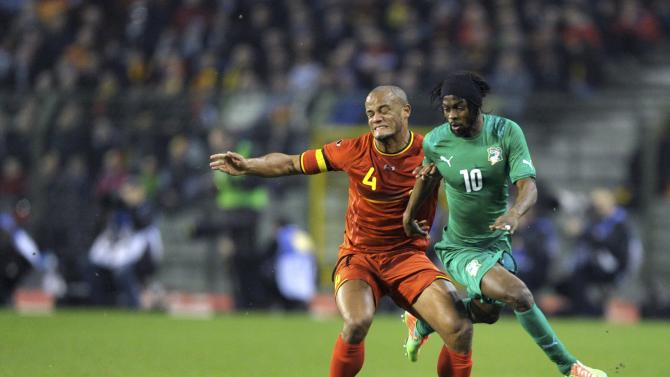 Belgium's Kompany and Ivory Coast's Gervinho battle for the ball during their international friendly soccer match at King Baudouin Stadium in Brussels
