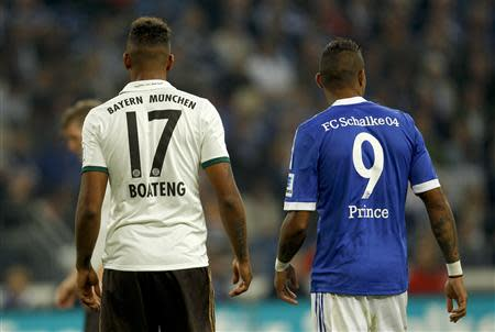 Schalke 04's Kevin Prince Boateng and his brother Jerome Boateng of Bayern Munich stand during the German first division Bundesliga soccer match in Gelsenkirchen