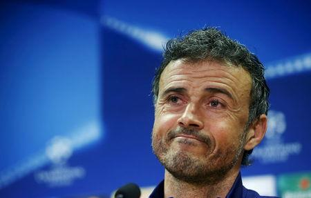 Barcelona's coach Luis Enrique attends a news conference a day ahead of their Champions League soccer match against AS Roma, at the Joan Gamper training grounds outside Barcelona, Spain