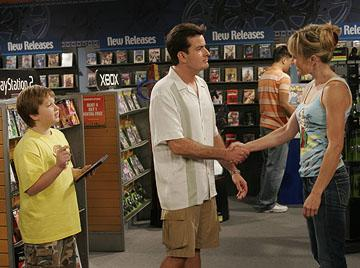 """Jake (Angus T. Young) gives Charlie (Charlie Sheen) a hard time when he tries to hit on a woman CBS' """"Two and a Half Men"""""""