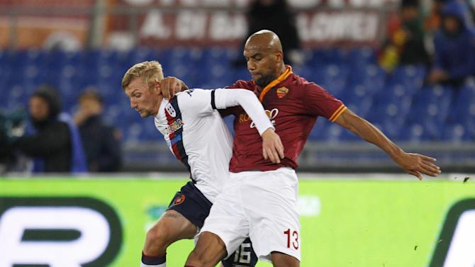 Cagliari midfielder Sebastien Eriksson, of Sweden, left, and AS Roma defender Maicon, of Brazil, fight for the ball during a Serie A soccer match between AS Roma and Cagliari, at Rome's Olympic stadium, Monday, Nov. 25, 2013