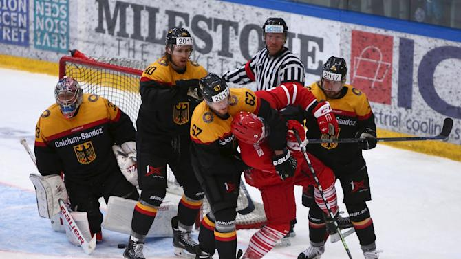 Bernhard Ebner fights Frederik Storm during their Ice Hockey, Friendly International, Denmark vs. Germany at SE Arena, Vojens