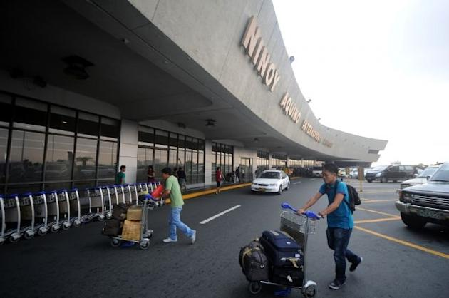 Passengers arrive at the Ninoy Aquino International Airport (NAIA) Terminal 1 in Manila
