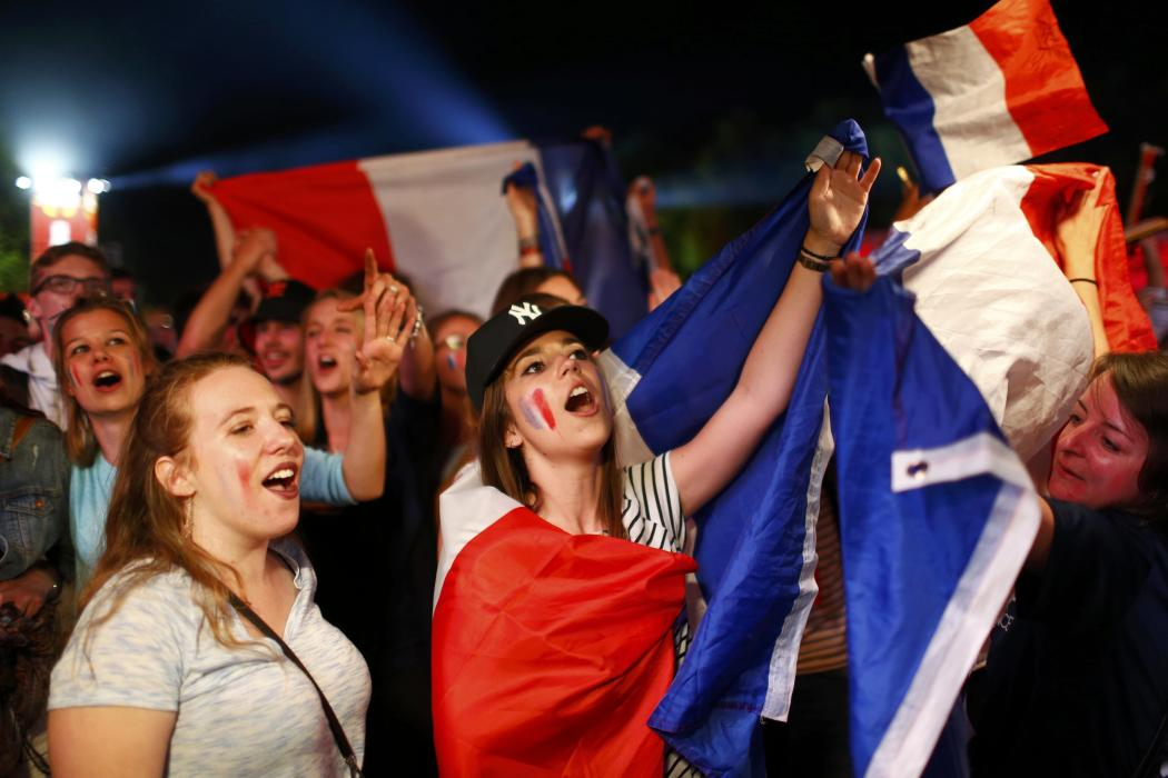 Fans of France celebrate victory after the Euro 2016 match between France and Germany at a public screening in Berlin