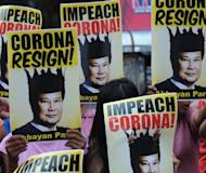 Protesters rally against Supreme Court chief justice Renato Corona in Manila in 2011. Philippine senators on Tuesday found Corona, the country's top judge, guilty of corruption, paving the way for him to be sacked in the biggest win of President Benigno Aquino's anti-graft crusade