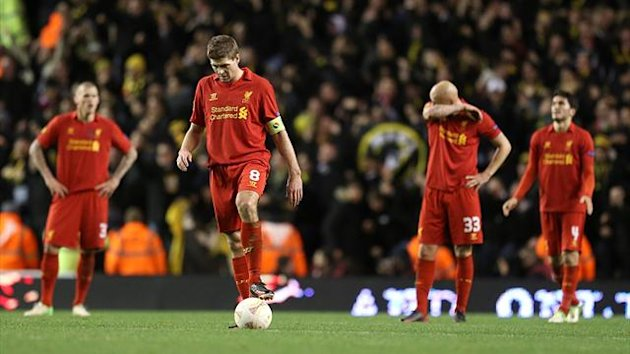 Liverpool's Jonjo Shelvey (second right) and Steven Gerrard (second left) appear dejected after Young Boys' Elsad Zverotic (not in picture) scored his team's second goal