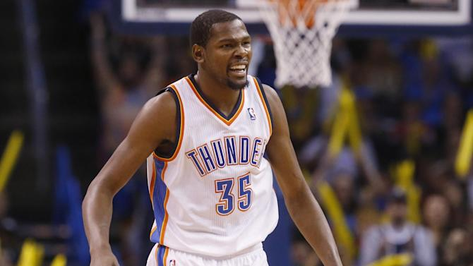 Oklahoma City Thunder forward Kevin Durant (35) celebrates following a basket by teammate Kendrick Perkins in the second quarter of an NBA basketball game against the Indiana Pacers in Oklahoma City, Sunday, Dec. 8, 2013