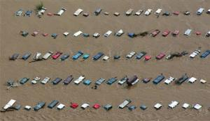 An aerial view of vehicles submerged in flood waters along the Sough Platte River near Greenley