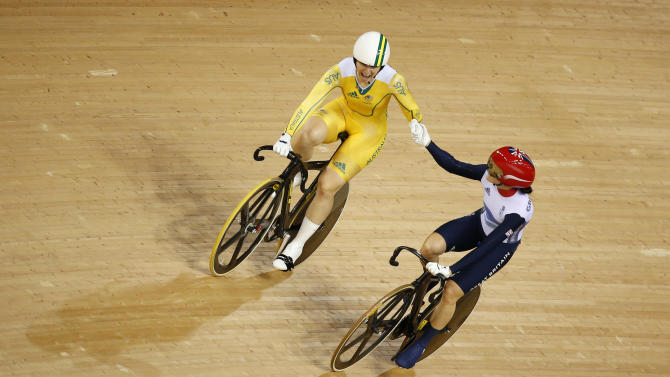 Australia's Anna Meares (in yellow) shakes hands with Britain's Victoria Pendleton after their track cycling women's sprint finals at the Velodrome during the London 2012 Olympic Games