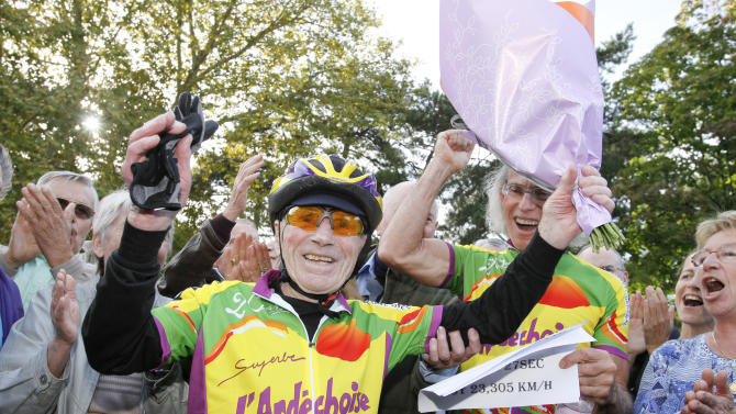 French centenarian Robert Marchand reacts after he set a record for the fastest 100-year-old to cover 100km (62 miles) at the outdoor Tete-d'Or Velodrome track in Lyon