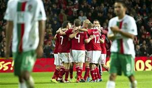 Danish players celebrate after defeating Portugal in their Euro 2012 qualifying soccer match in Copenhagen