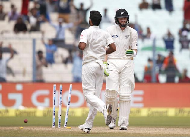 New Zealand's Martin Guptill is bowled on the second day of the second cricket test match against India, in Kolkata, India, Saturday, Oct. 1, 2016. (AP Photo/Saurabh Das)
