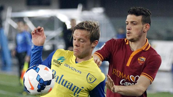Chievo's Dejan Lazarevic, left, of Slovenia, is chased by AS Roma's Alessandro Florenzi during a Serie A soccer match at Bentegodi stadium in Verona, Italy, Saturday, March 22, 2014