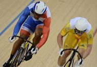 France's Gregory Bauge (L) and Australia's Shane Perkins (R) compete in the London 2012 Olympic Games men's sprint semi-final cycling event at the Velodrome in the Olympic Park in East London on August 6, 2012