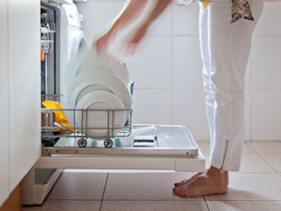 woman using a dishwasher