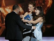 "Zooey Deschanel (R) and sister Emily Deschanel present the award for Outstanding Supporting Actor In A Comedy Series to Tony Hale for his role in ""Veep"" at the 65th Primetime Emmy Awards in Los Angeles September 22, 2013. REUTERS/Mike Blake"
