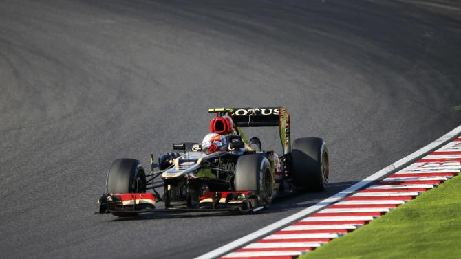 Lotus Formula One driver Grosjean of France races during the Japanese F1 Grand Prix at the Suzuka circuit