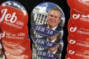 Campaign buttons for Republican U.S. presidential candidate and former Florida Governor Bush are displayed prior campaign kickoff rally in Miami