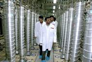 "Iranian President Mahmoud Ahmadinejad inspects centrifuges during a visit to the Natanz uranium enrichment facility in 2008. Iran ""will not retreat an iota"" from its nuclear rights, Ahmadinejad has said, ahead of weekend talks in Istanbul with world powers over Tehran's atomic activities"