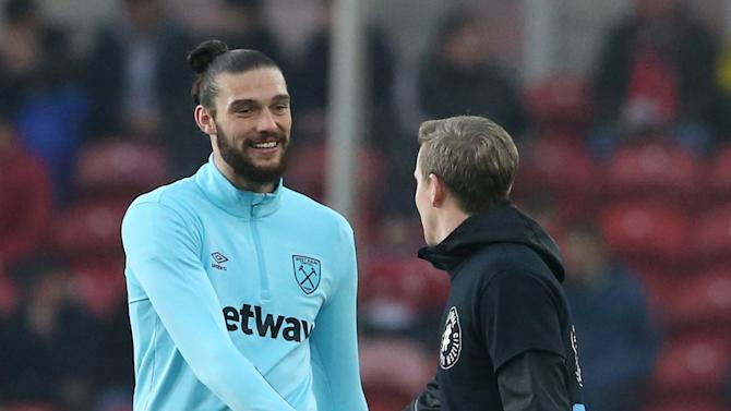 West Ham United's Andy Carroll and Middlesbrough's Grant Leadbitter shake hands before the match