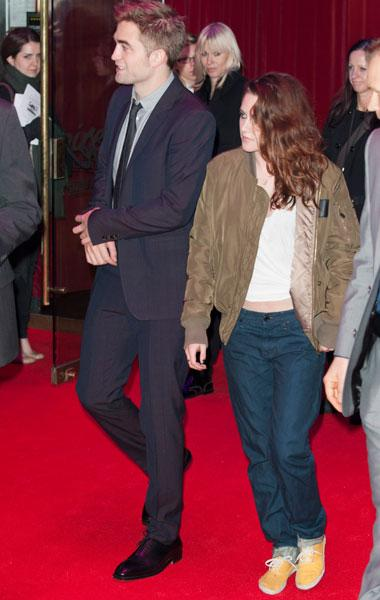 However as soon as the premiere was over, the actress changed into a more comfortable outfit complete with a slouchy jacket, baggy pants, sneakers and her trademark tummy-baring white t-shirt. Picture
