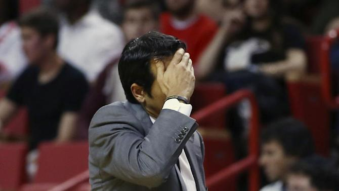 Miami Heat coach Erik Spoelstra reacts after one of his players fouled a Cleveland Cavaliers player during the first half of an NBA basketball game in Miami, Saturday, Dec. 14, 2013