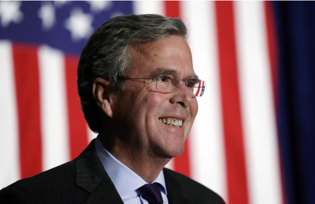 FILE - In this Oct. 6, 2015, file photo, Republican presidential candidate former Florida Gov. Jeb Bush reacts to a supporter during the Scott County Republican Party's Ronald Reagan Dinner in Dav