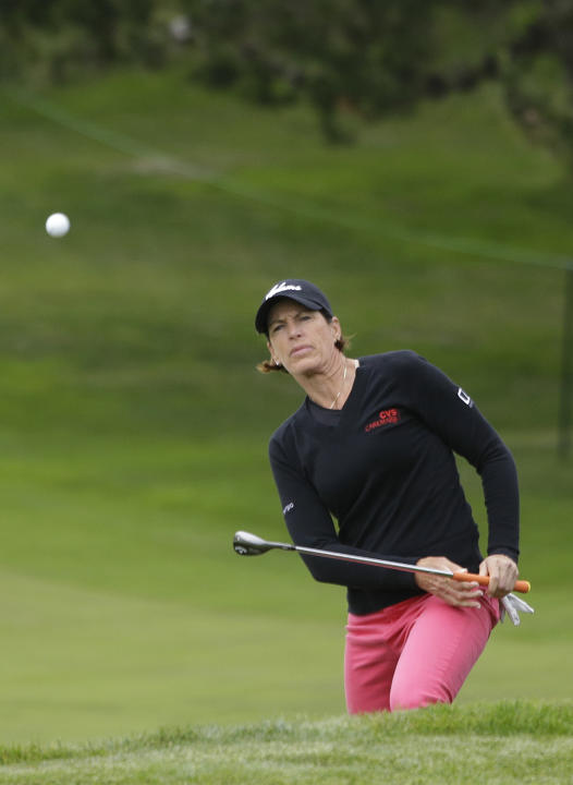 Juli Inkster chips the ball up to the fourth green of the Lake Merced Golf Club during the first round of the Swinging Skirts LPGA Classic golf tournament Thursday, April 24, 2014, in Daly City, Calif