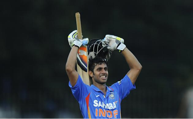Indian Manoj Tiwary celebrates scoring a