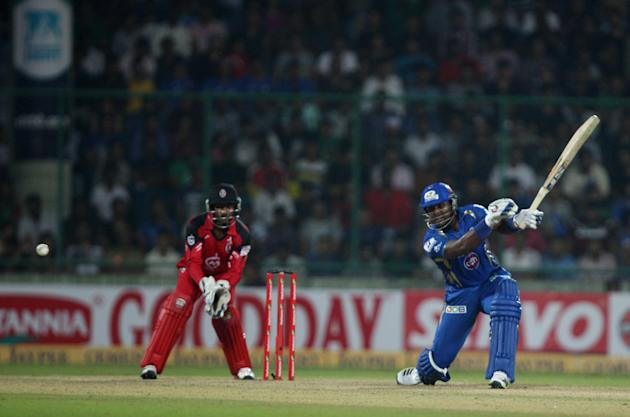 MI batsman Dwayne Smith in action during the 2nd CLT20 semi-final match between Mumbai Indians and Trinidad & Tobago at Feroz Shah Kotla, Delhi on Oct. 5, 2013. (Photo: IANS)