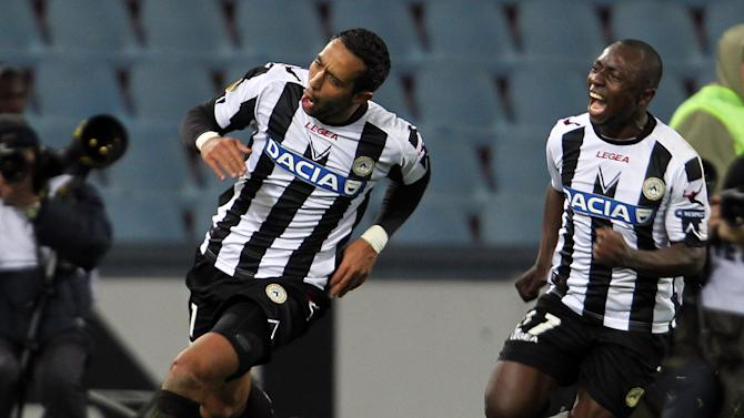 Udinese's Medhi Benatia, left,  celebrates with teammate Pablo Armero after scoring during the Europa League, group I soccer match between Udinese and Atletico Madrid, at the Udine Friuli stadium, Italy, Thursday, Oct. 20, 2011. Udinese won 2-0. (AP Photo/Paolo Giovannini)