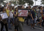 Participants display their placards during the annual Pride March in Manila, Philippines, Saturday, Dec. 3, 2011. Lesbians, gays, bisexual and transgenders called for the urgent need to pass the anti-discrimination bill and for government protection from hate crimes committed against them. (AP Photo/Pat Roque)