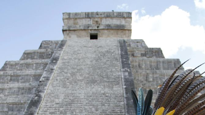 Mayan dancers perform in front of the Kukulkan Pyramid in Chichen Itza, Mexico, Thursday, Dec. 20, 2012. American seer Star Johnsen-Moser led a whooping, dancing, drum-beating ceremony Thursday in the heart of  Mayan territory to consult several of the life-sized crystal skulls, which adherents claim were passed down by the ancient Maya. (AP Photo/Israel Leal)