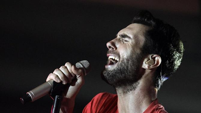 """FILE - This Nov. 16, 2011 file photo shows musician Adam Levine, of Maroon 5, performing with the band at the Google and T-Mobile party celebrating the launch of Google Music in Los Angeles. The latest release by Maroon 5, """"Overexposed,"""" was released on Tuesday, June 26.  (AP Photo/Matt Sayles, file)"""
