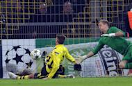 Dortmund striker Julian Schieber scores against Manchester City during their UEFA Champions League Group D match. The German side won 1-0 to dump City out of Europe. With their European season over, City will now focus entirely on defending their Premier League crown with the huge Manchester derby against leaders United next up on Sunday