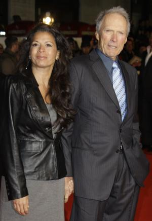 """FILE - In this Jan. 31, 2010 file photo, U.S. Director Clint Eastwood, right, arrives with his wife, Dina Eastwood, on the red carpet for the UK premiere of """"Invictus"""" at London's Leicester Square. A new E! reality show, """"Mrs. Eastwood & Company,"""" debuts Sunday, May 20, 2012. (AP Photo/Joel Ryan, File)"""