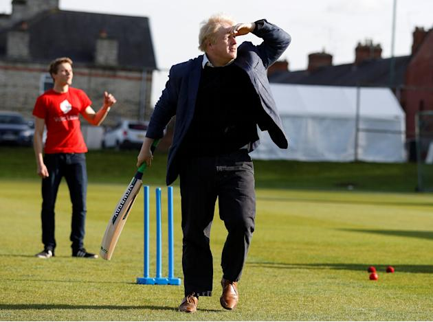 Former London Mayor Boris Johnson plays cricket during a Vote Leave event in Chester le Street