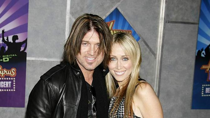Billy Ray Cyrus and wife Tish arrive to Disney's Premiere of 'Hannah Montana & Miley Cyrus: Best Of Both Worlds' held at the El Capitan Theatre on January 17, 2008 in Hollywood, California.