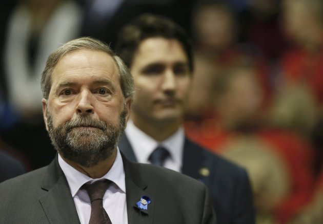 New Democratic Party leader Thomas Mulcair (L) and Liberal leader Justin Trudeau attend a regimental funeral for three Royal Canadian Mounted Police officers who were killed last week in Moncton, New Brunswick, June 10, 2014.  REUTERS/Christinne Muschi