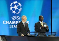Former player George Weah (R) of Liberia draws for the UEFA Champions League group stage in Monaco