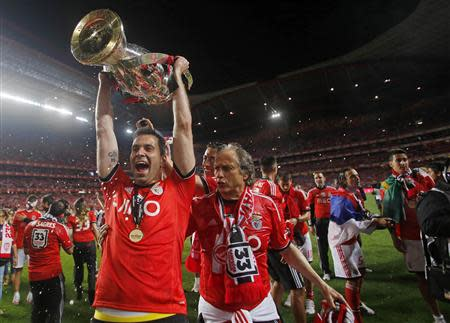 Benfica's goalkeeper Artur Moraes holds up the Portuguese Premier League trophy title with Benfica coach Jorge Jesus after beating Olhanense at Luz stadium in Lisbon