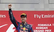 Red Bull Formula One driver Sebastian Vettel of Germany celebrates winning the Korean F1 Grand Prix at the Korea International Circuit in Yeongam, October 6, 2013. REUTERS/Kim Hong-Ji