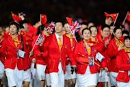 Members of the Chinese delegation arrive during the opening ceremony of the London 2012 Olympic Games, on July 27, at the Olympic Stadium in London