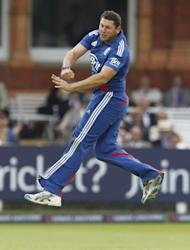 England's Tim Bresnan celebrates taking the wicket of Australia's Steven Smith for 8 runs during the first One day International (ODI) cricket match between England and Australia