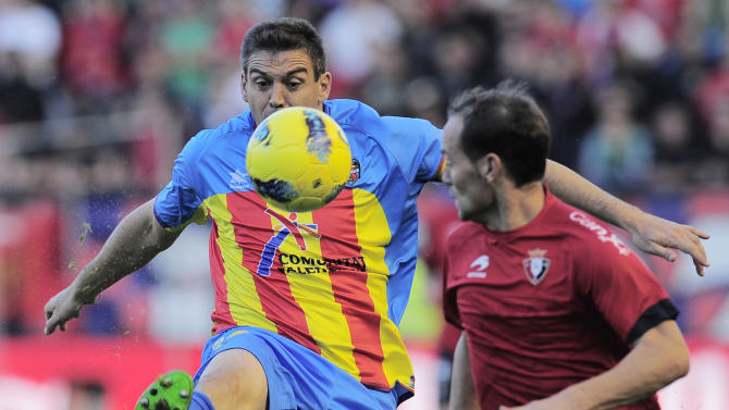 Levante's Sergio Ballesteros, left, duels for the ball in front Osasuna's Nino, during their Spanish La Liga soccer match, at Reyno de Navarra stadium in Pamplona, northern Spain, Sunday Oct. 30, 2011. Levante lost the match 2-0. (AP Photo/Alvaro Barrientos)
