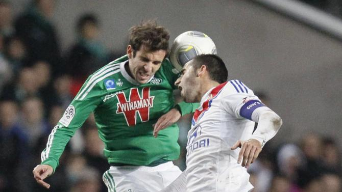 Gonalons of Olympique Lyon challenges Corgnet of St Etienne during French Ligue 1 match in Saint-Etienne