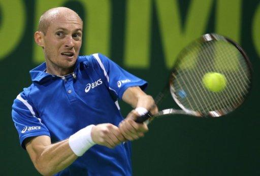 Russia's Nikolay Davydenko returns the ball to Victor Hanescu of Romania during the first day of the 2013 ATP Qatar Open in Doha on December 31, 2012. Davydenko, one of only a handful of players to have beaten Rafael Nadal and Roger Federer in the same tournament, has a new year's resolution of making a last bid to return the world's top 20 before retirement